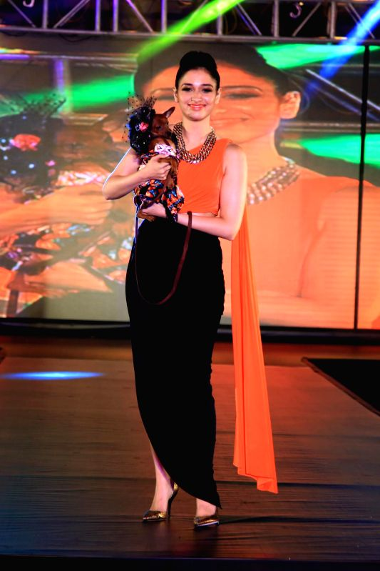 Actor Tamannaah walk the ramp with dogs during the promotion of film Entertainment in Bengaluru on August 5, 2014. - Tamannaah