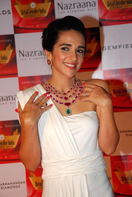 Actor Tara Sharma during the 10th Annual Gemfields and Nazraana Retail Jeweller India Awards 2014 in Mumbai on July 19, 2014. (Photo : IANS) - Tara Sharma