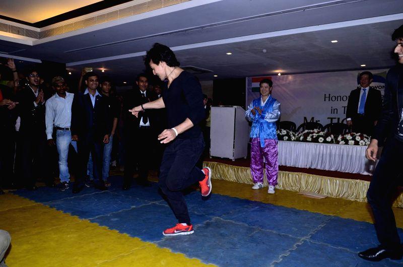 Actor Tiger Shroff displays his Taekwondo in Mumbai on July 30, 2014.