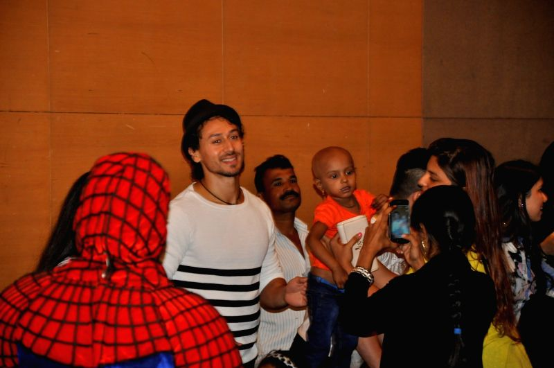 Actor Tiger Shroff during a charity event for cancer affected kids from Cancer Patients Aid Association (CPAA), in Mumbai, on May 22, 2016. - Tiger Shroff