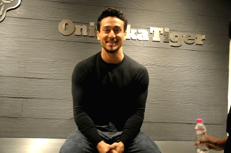 Actor Tiger Shroff during a programme organised to launch a Onitsuka Tiger - Japanese shoe company - store in New Delhi, on July 20, 2018. - Tiger Shroff
