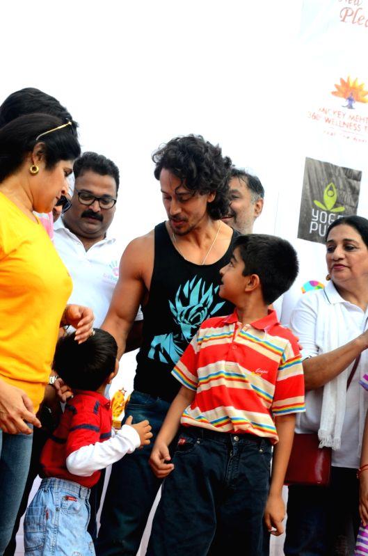 Actor Tiger Shroff during the Lokhandwala Street Festival in Mumbai on April 16, 2017. - Tiger Shroff