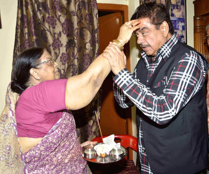 Actor turned politician and BJP MP from Patna Sahib Shatrughan Sinha with his sister on Raksha Bandhan in Patna on Aug 10, 2014.