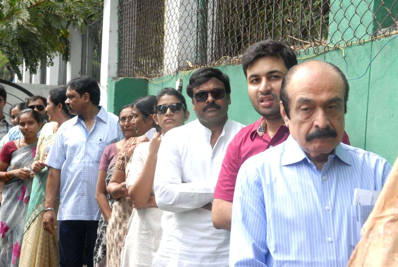 Actor-turned politician Chiranjeevi shows his fore finger marked with phosphorous ink after casting his vote at a polling booth in Hyderabad on April 30, 2014.