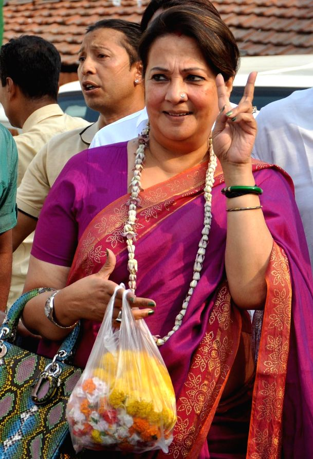 Actor-turned-politician Moon Moon Sen arrives to attend a programme organised to celebrate Trinamool Congress's performance in 2014 Lok Sabha Elections at party supremo Mamata Banerjee's residence in