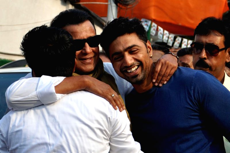 Actor-turned-politicians Mithun Chakraborty and Dev during a programme organised to celebrate Trinamool Congress's performance in 2014 Lok Sabha Elections at party supremo Mamata Banerjee's residence - Mithun Chakraborty