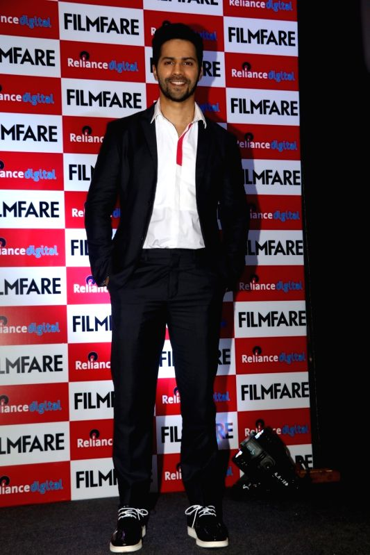 Actor Varun Dhavan during the launch of Filmfare August 2016 cover issue, in Mumbai on Aug 1, 2016. - Varun Dhavan