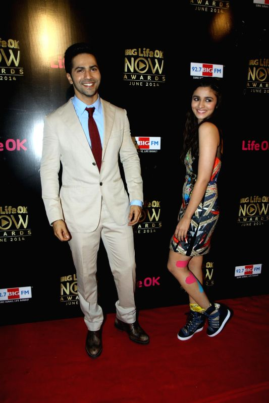 Actor Varun Dhawan and Alia Bhatt during the Big Life OK Now Award 2014 in Mumbai on June 23, 2014. - Varun Dhawan