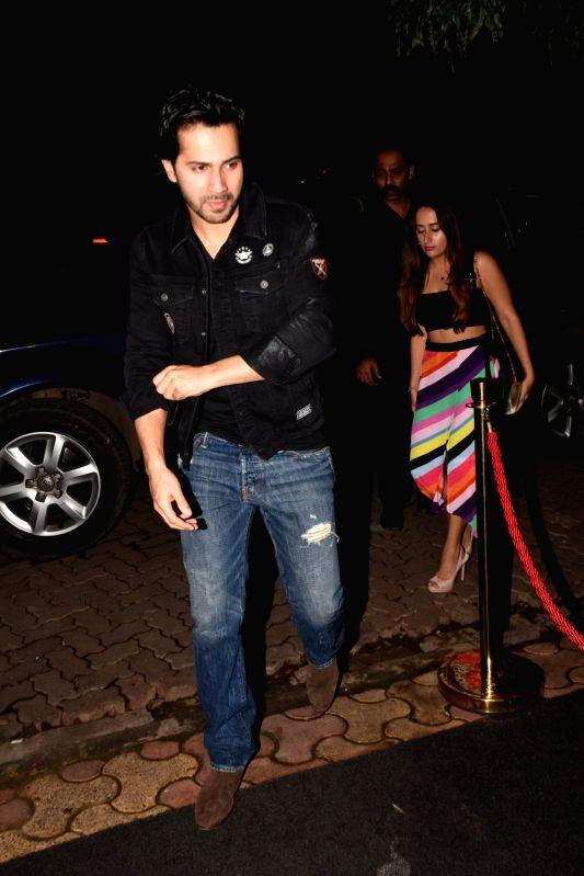 Actor Varun Dhawan and fashion designer Natasha Dalal  at the producer Dinesh Vijan birthday celebration in Mumbai on July 26, 2018. - Varun Dhawan