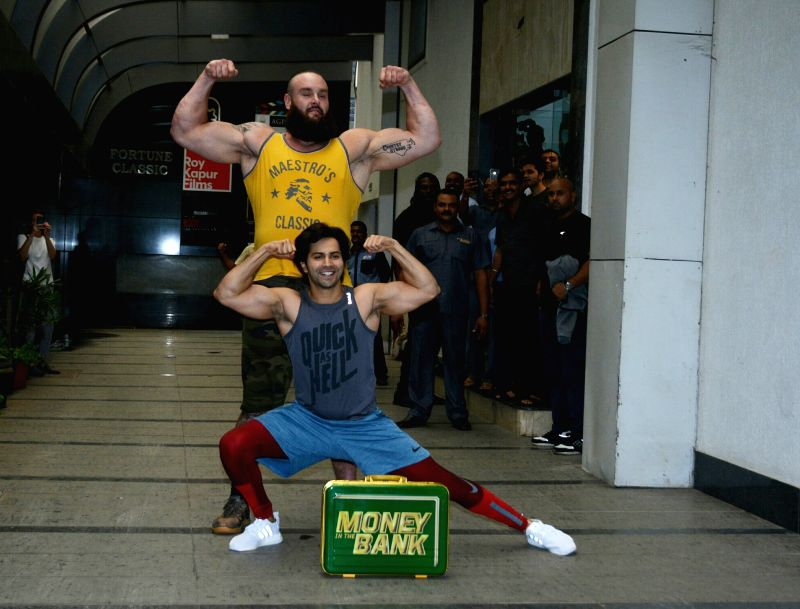 Actor Varun Dhawan and wrestler Braun Strowman seen at a gym in Khar, Mumbai on July 20, 2018. - Varun Dhawan