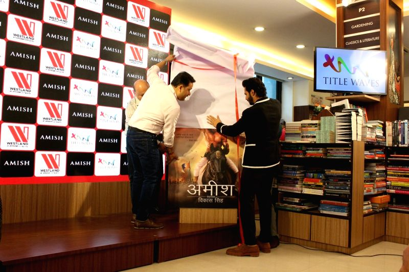 "Actor Varun Dhawan at the launch of Amish Tripathi's book ""Suhaldev"" in Mumbai's Bandra, on June 11, 2018. - Varun Dhawan and Tripathi"