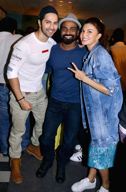 Actor Varun Dhawan, choreographer and filmmaker Remo D`Souza and actress Jacqueline Fernandez during the screening of film Dishoom in Mumbai, on July 28, 2016. - Varun Dhawan