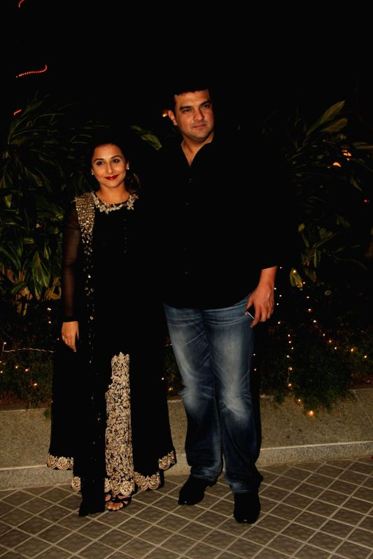 Actor Vidya Balan and Siddharth Roy Kapur  during the birthday party of Farah Khan in Mumbai, on jan. 08, 2015. - Vidya Balan and Siddharth Roy Kapur