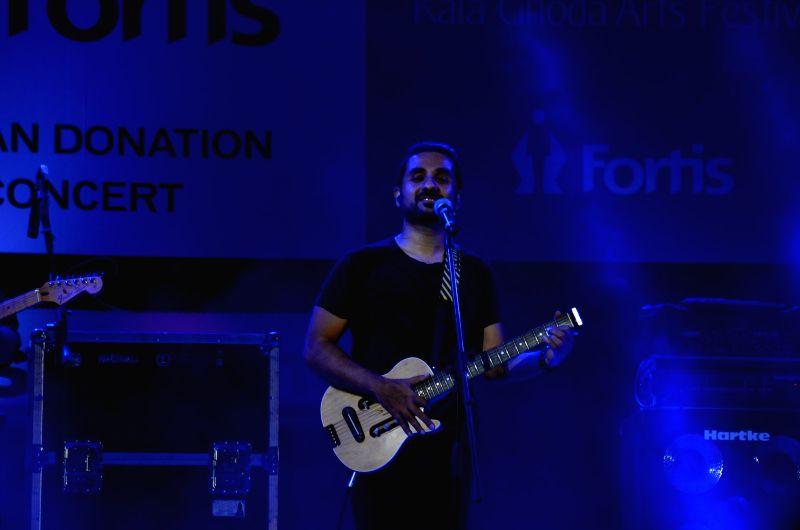 Actor Vir Das performs for Pepe Jeans music festin at Kala Ghoda in Mumbai, on Feb 13, 2016. - Vir Das