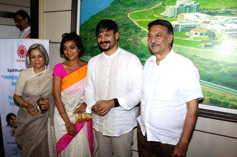 Actor Vivek Oberoi along with his mother Yashodhara Oberoi wife Priyanka Oberoi and father Suresh Oberoi during spiritual talk by Brahma Kumari sister Shivani on Inner Peace and Inner Power ... - Vivek Oberoi