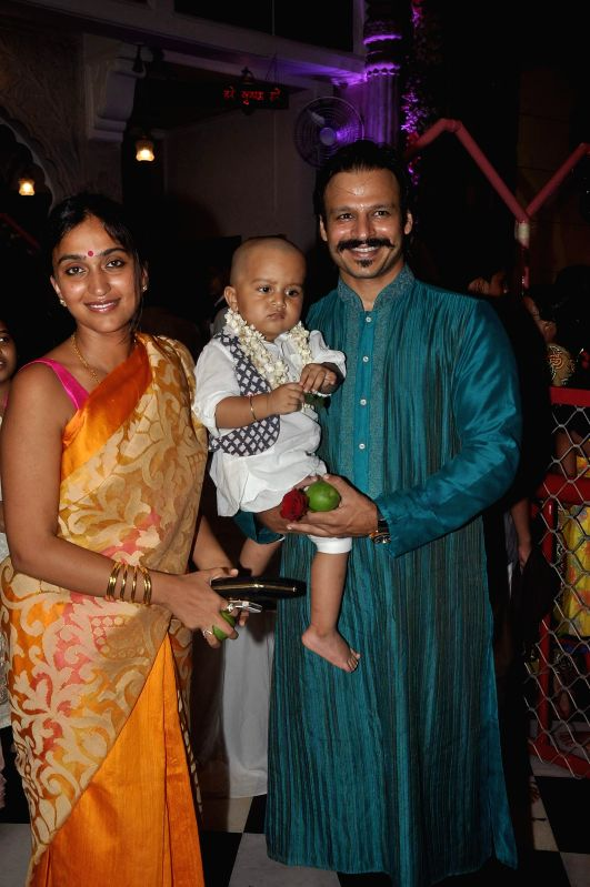 Actor Vivek Oberoi along with his wife Priyanka Alva and son Vivaan Veer at ISKCON temple to seek the blessing of Lord Krishna on the occasion of Janamashtmi, in Mumbai, on Aug. 17, 2014.