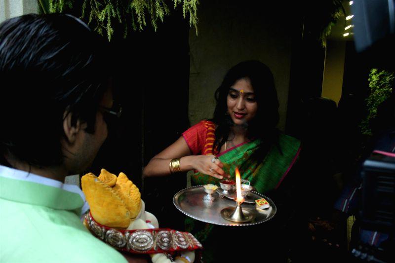 Actor Vivek Oberoi and Priyanka Alva Oberoi during the Ganesh Chaturthi celebrations at his residence in Mumbai on Aug 29, 2014.