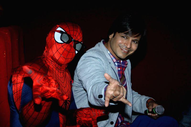 Actor Vivek Oberoi meets Spiderman at PVR, in Mumbai, on April 18, 2014.