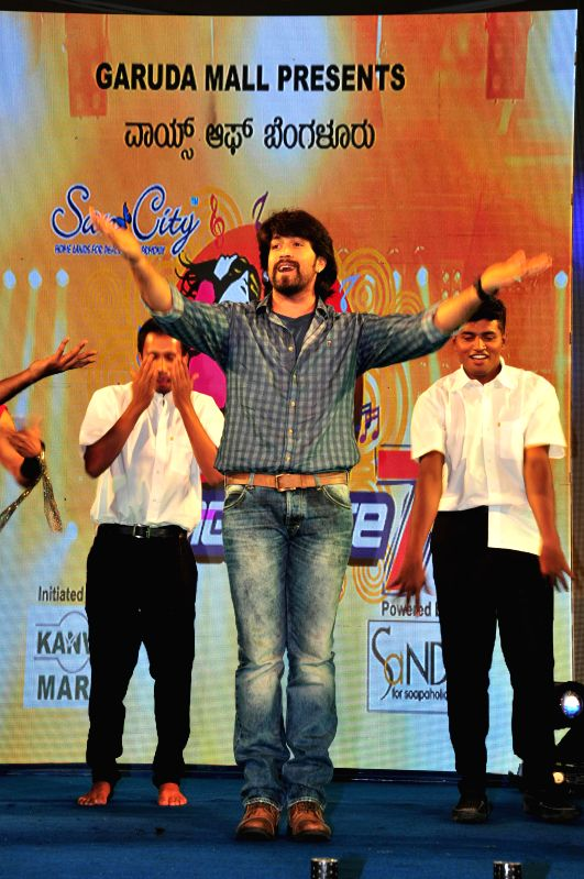 Actor Yash performs during the launch of Voice of Bangalore Season-7 in Bangalore on July 12, 2014. - Yash