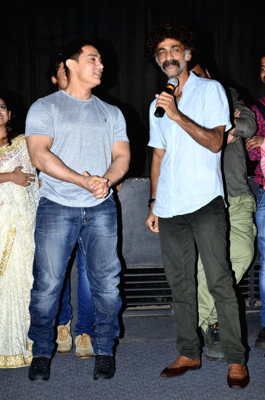 Actors Aamir Khan and Makarand Deshpande during the special screening of the Marathi film Saturday Sunday in Mumbai on August 6, 2014. - Aamir Khan and Makarand Deshpande