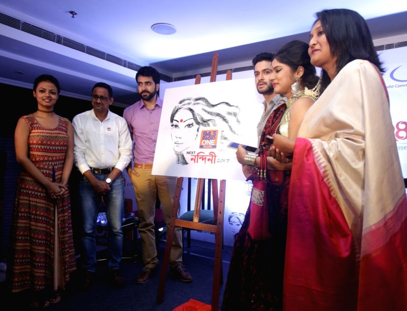 Actors Abir Chatterjee and Bikram Chatterjee with Station Director of 94.3 Radio One Eathesham Azam during a programme organised to launch new logo of Radio One's Next Nandini in Kolkata, on ... - Abir Chatterjee and Bikram Chatterjee