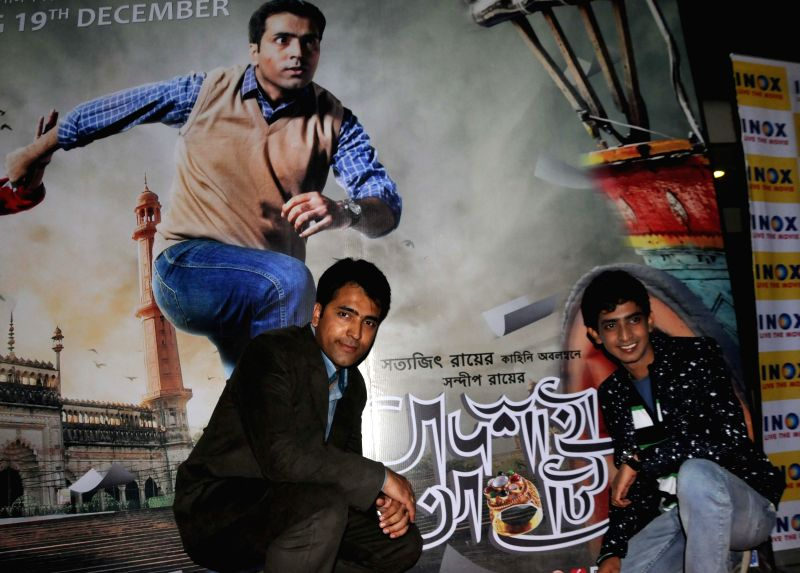 Actors Abir Chatterjee and Sourav during ​the premiere of B​engali film `Badshahi Angti` in Kolkata, on Dec 19, 2014. - Abir Chatterjee and Sourav