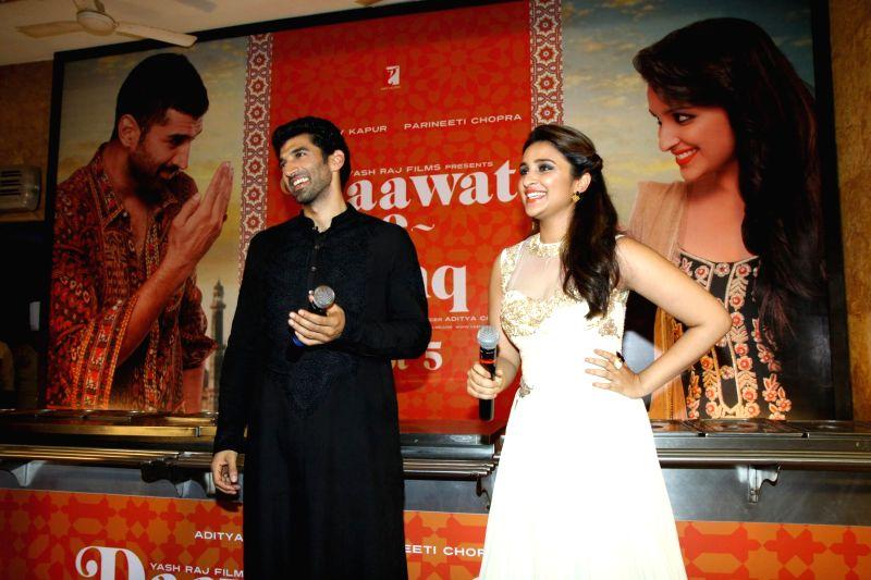 Actors Aditya Roy Kapur and Parineeti Chopra during the trailer launch of upcoming film Daawat E Ishq at YRF Studios in Mumbai on July 7, 2014. - Aditya Roy Kapur and Parineeti Chopra