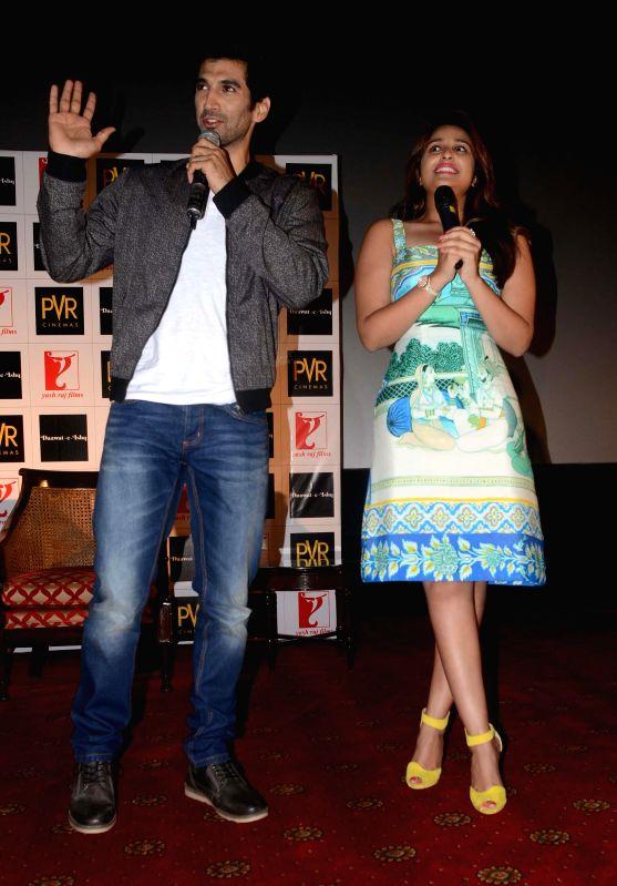 Actors Aditya Roy Kapur and Parineeti Chopra during the song launch of their upcoming film Daawat-e-Ishq in New Delhi on July 17, 2014. - Aditya Roy Kapur and Parineeti Chopra