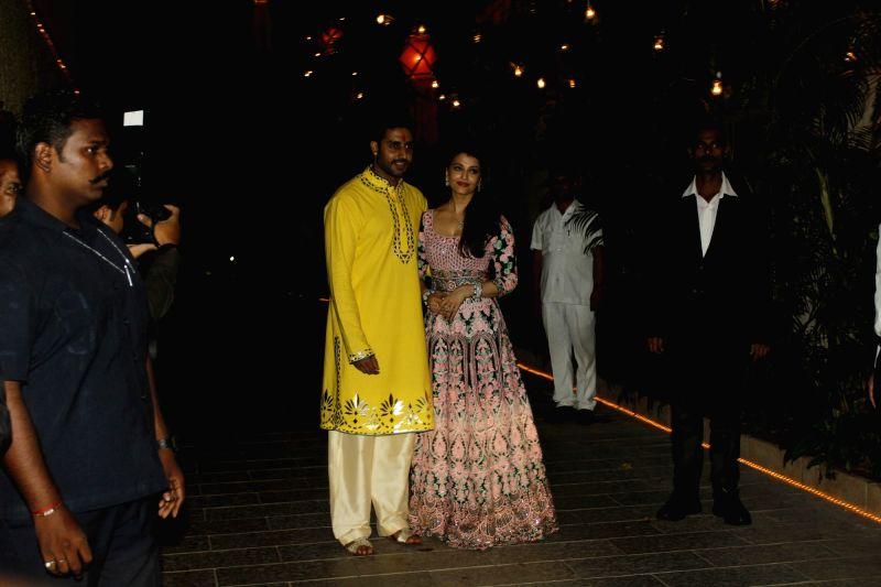 Actors Aishwarya Rai and her husband Abhishek Bachchan arrive to attend the Amitabh Bachchan's Diwali party in Mumbai on Nov 11, 2015. - Aishwarya Rai and Abhishek Bachchan