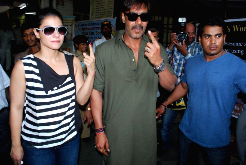 Actors Ajay Devgan and Kajol arrive to cast their votes at a polling booth during the sixth phase of 2014 Lok Sabha Polls  in Mumbai on April 24, 2014.