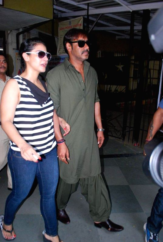 Actors Ajay Devgan and Kajol show their fore fingers marked with phosphorous ink after casting their votes at a polling booth during the sixth phase of 2014 Lok Sabha Polls  in Mumbai on April 24, ...