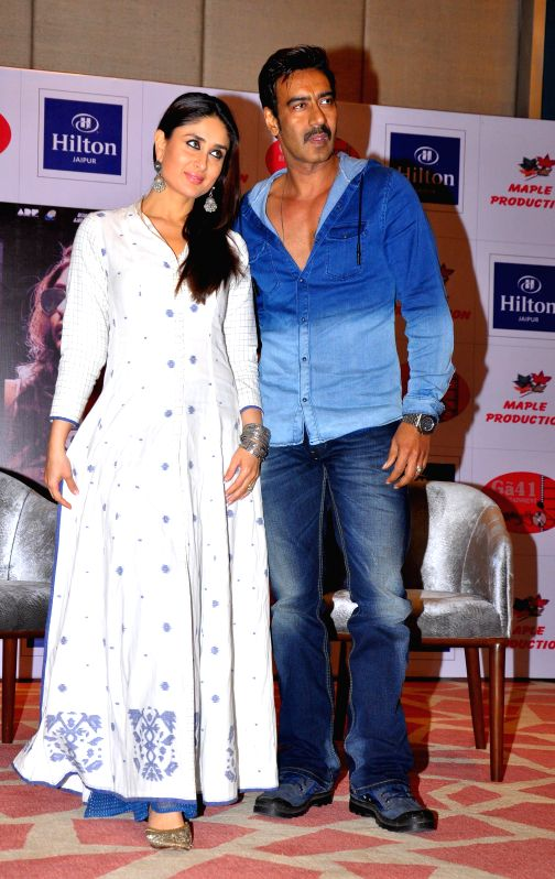 Actors Ajay Devgan and Kareena Kapoor during a press conference to promote their upcoming film `Singham Returns` in Jaipur on Aug 7, 2014. - Ajay Devgan and Kareena Kapoor
