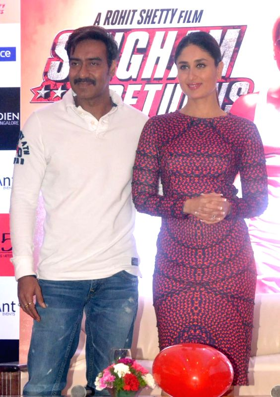 Actors Ajay Devgan and Kareena Kapoor during a press conference to promote their upcoming film `Singham Returns` in Bangalore on Aug 8, 2014. - Ajay Devgan and Kareena Kapoor