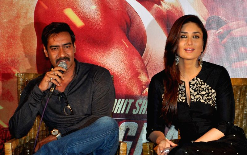 Actors Ajay Devgan and Kareena Kapoor during a press conference to promote their upcoming film `Singham Returns` in Kolkata on Aug 10, 2014. - Ajay Devgan and Kareena Kapoor