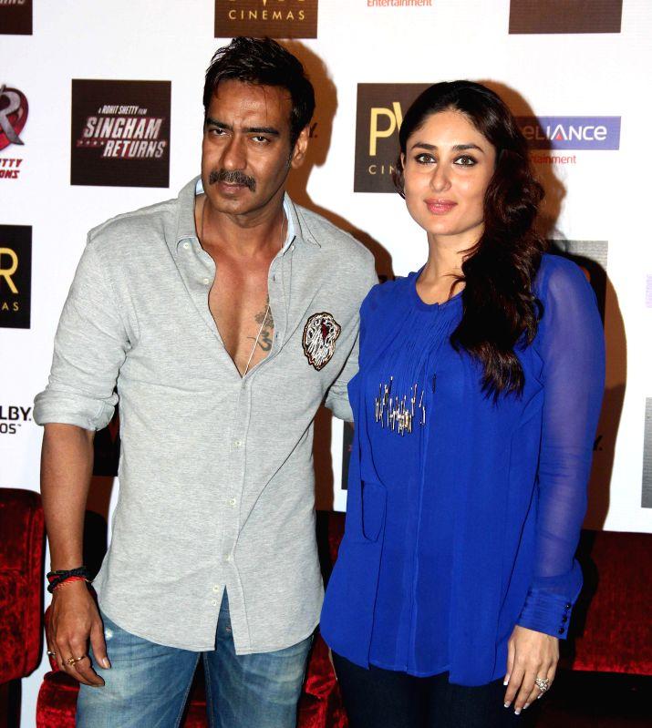 Actors Ajay Devgan and Kareena Kapoor during the launch of film Singham Returns in Mumbai on 30 July 2014. - Ajay Devgan and Kareena Kapoor