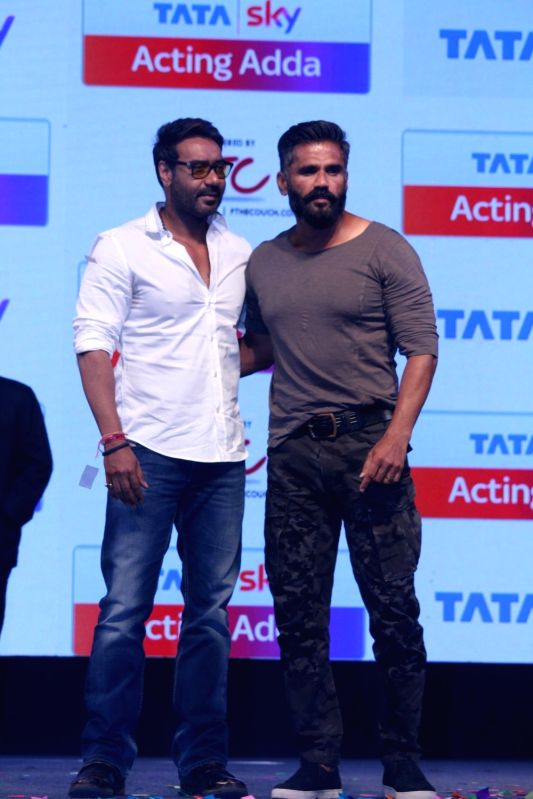 Actors Ajay Devgan and Suniel Shetty during the launch of Tata Sky Acting Adda, in Mumbai, on May 16, 2017. - Ajay Devgan and Suniel Shetty
