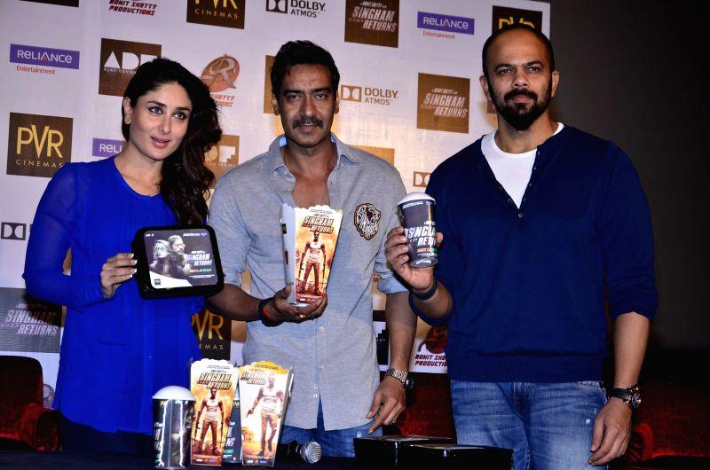 Actors Ajay Devgan, Kareena Kapoor and filmmaker Rohit Shetty during the launch of film Singham Returns in Mumbai on 30 July 2014. - Ajay Devgan, Kareena Kapoor and Rohit Shetty