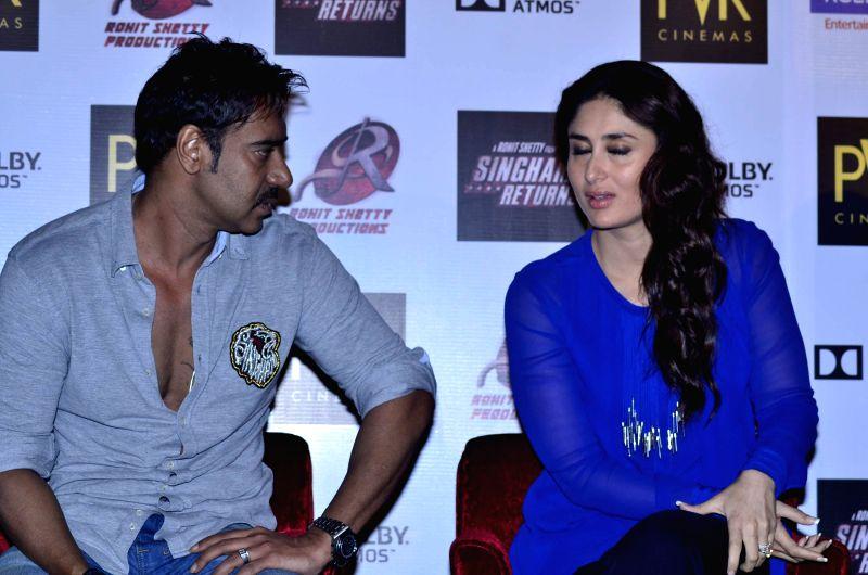 Actors Ajay Devgan, Kareena Kapoor during the launch of film Singham Returns in Mumbai on 30 July 2014. - Ajay Devgan and Kareena Kapoor