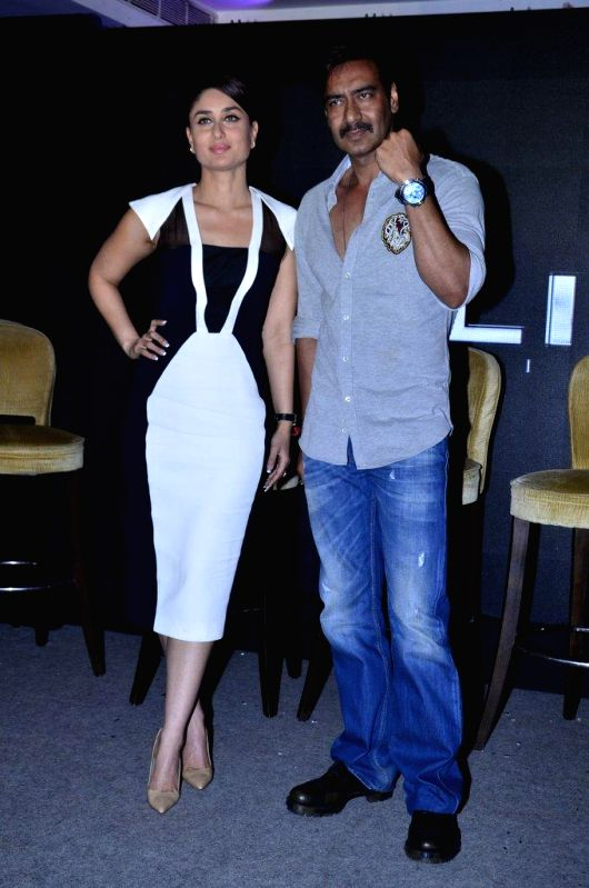 Actors Ajay Devgn and Kareena Kapoor during the launch of Singham time wear collection by Police in Mumbai, on August 9, 2014. - Ajay Devgn and Kareena Kapoor