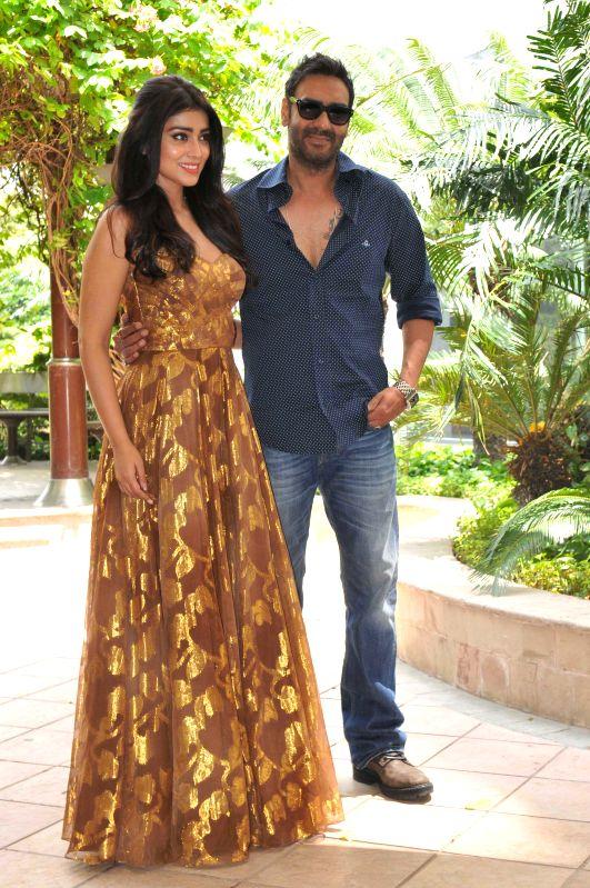 Actors Ajay Devgn and Shriya Saran during a photo shoot organised to promote their upcoming film `Drishyam`  in New Delhi, on July 28, 2015. - Ajay Devgn and Shriya Saran