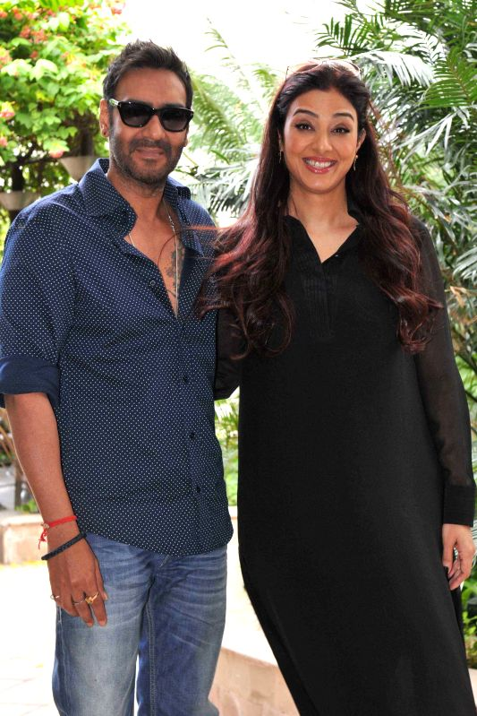 Actors Ajay Devgn and Tabu during a photo shoot organised to promote their upcoming film `Drishyam`  in New Delhi, on July 28, 2015. - Ajay Devgn and Tabu