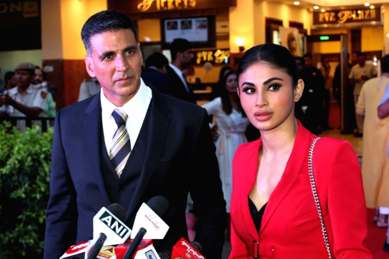 """Actors Akshay Kumar and Mouni Roy talk to the media at the promotions of their upcoming film """"Gold"""", in New Delhi on Aug 12, 2018. - Akshay Kumar and Mouni Roy"""