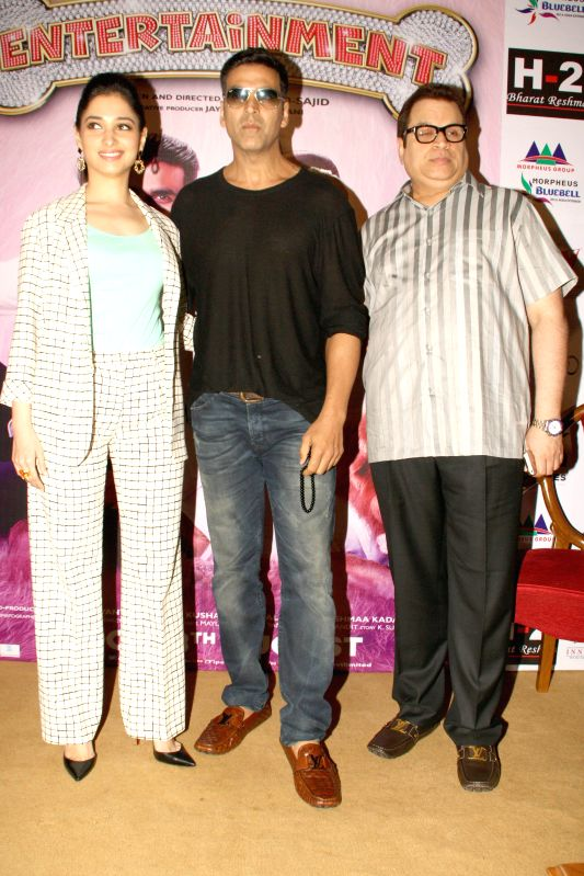 Actors Akshay Kumar and Tamannaah Bhatia and producer Ramesh Taurani during a press conference to promote their upcoming film `Entertainment` in New Delhi on Aug 7, 2014. - Akshay Kumar and Tamannaah Bhatia