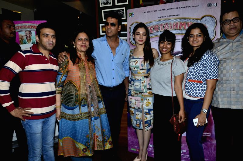 Actors Akshay Kumar and Tamannaah Bhatia during the promotion of film Entertainment and support of a charity exhibition in Mumbai, on August 2, 2014. - Akshay Kumar and Tamannaah Bhatia