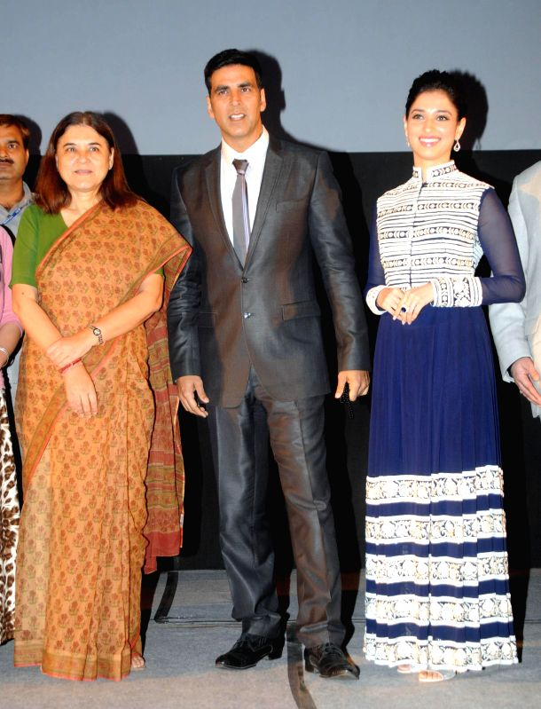 Actors Akshay Kumar and Tamannaah Bhatia with Union Women and Child Welfare Minister Maneka Gandhi during premiere of the film `Entertainment` in New Delhi on Aug 7, 2014. - Maneka Gandhi, Akshay Kumar and Tamannaah Bhatia