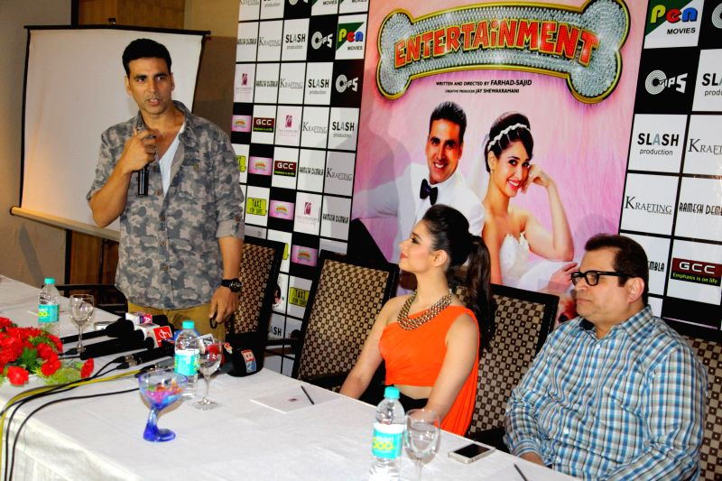 Actors Akshay Kumar and Tamannaah Filmmaker Ramesh Taurani during the promotion of film Entertainment in Bengaluru on August 5, 2014. - Tamannaah Filmmaker Ramesh Taurani and Akshay Kumar