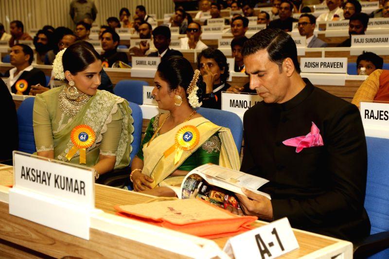 Actors Akshay Kumar, Sonam Kapoor and Surabhi C.M at the 64th National Film Awards Function, in New Delhi on May 3, 2017. - Akshay Kumar, Sonam Kapoor and Surabhi C.