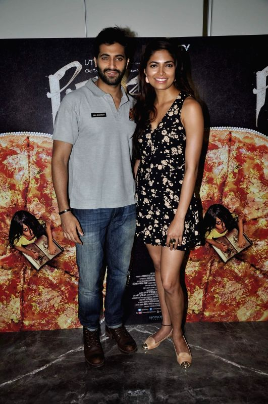 Actors Akshay Oberoi and Parvathy Omanakuttan during a media interaction of film Pizza in Mumbai, on July 1, 2014. - Akshay Oberoi and Parvathy Omanakuttan