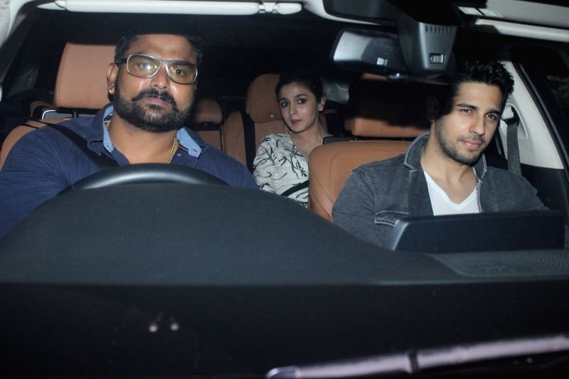 Actors Alia Bhatt and Sidharth Malhotra during filmmaker Karan Johar`s 45th birthday celebration party, in Mumbai on May 25, 2017. - Alia Bhatt and Sidharth Malhotra