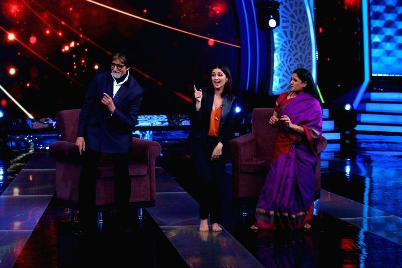 Actors Amitabh Bachchan and Parineeti shake a leg during the former`s show Aaj Ki Raat Hai Zindagi in Mumbai on Nov 27, 2015. - Parineeti